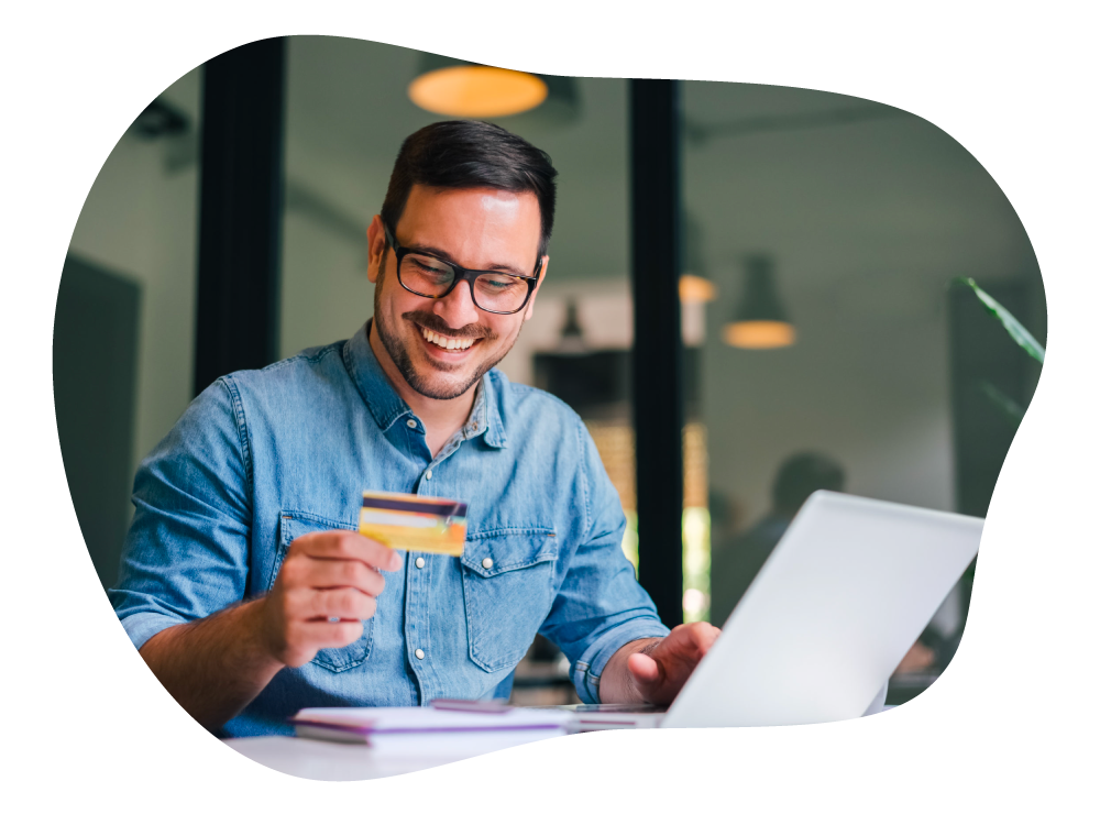 Businessman satisfied with paying business expenses using credit card
